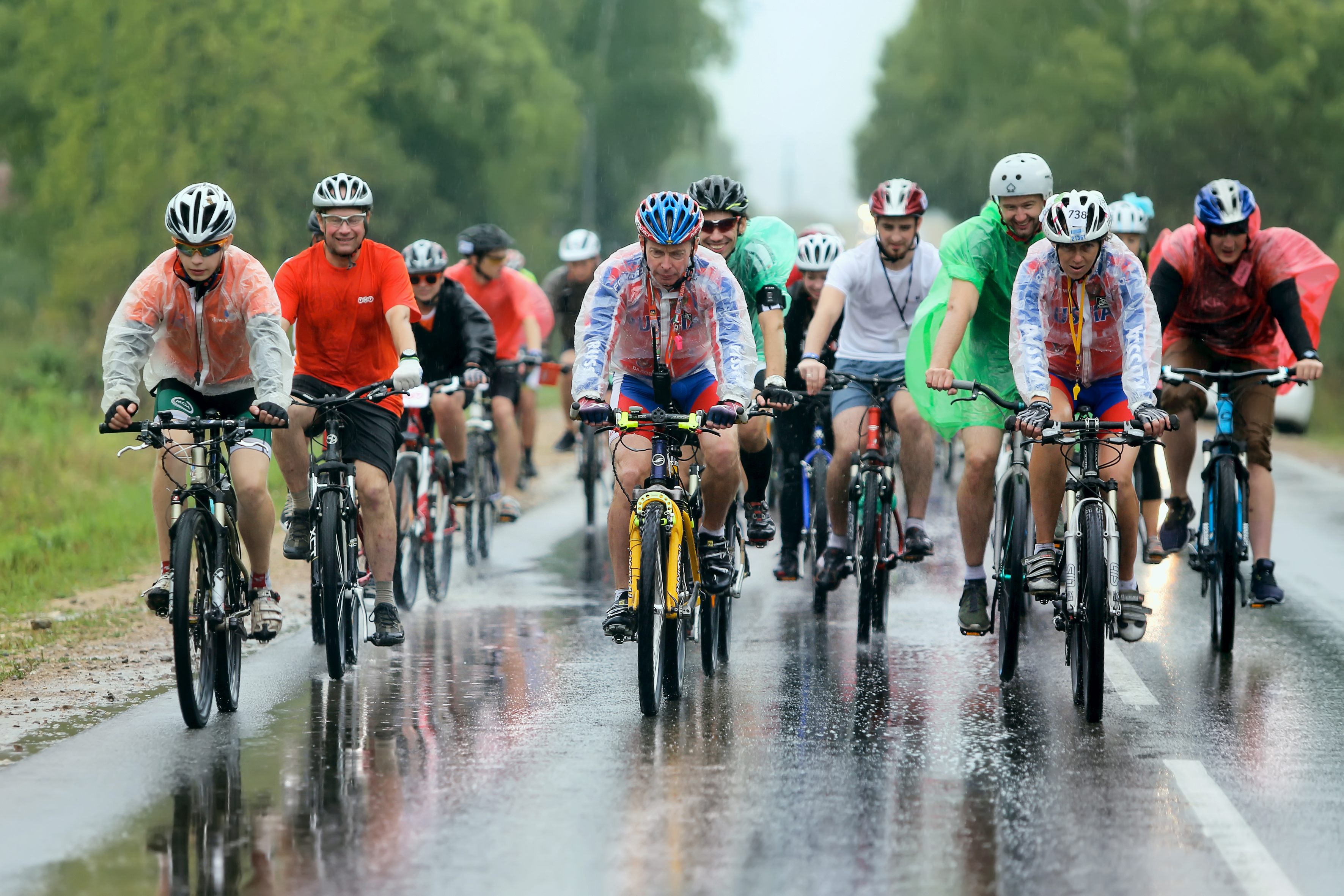 "MOSCOW, RUSSIA -€"" AUGUST 22: Charitable bicycle race from Kaluga to Moscow on August 22, 2014 .Russia. Cyclists compete in the rain"